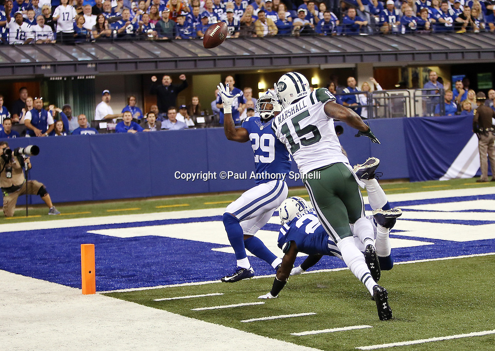 Indianapolis Colts strong safety Mike Adams (29) intercepts an end zone pass intended for New York Jets wide receiver Brandon Marshall (15) and stops a Jets drive during the 2015 NFL week 2 regular season football game against the New York Jets on Monday, Sept. 21, 2015 in Indianapolis. The Jets won the game 20-7. (©Paul Anthony Spinelli)