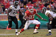 Kansas City Chiefs running back Larry Johnson (27) moves up field against pressure from Jacksonville defenders Deon Grant (37) and Marcellus Wiley (75) in the first half at Arrowhead Stadium in Kansas City, Missouri, December 31, 2006.  The Chiefs beat the Jaguars 35-30.<br />
