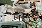 Armed Pakistani soldiers with machine gun  in village of Pattika, Pakistan