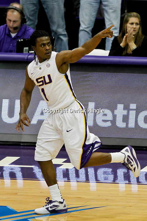 January 2, 2012; Baton Rouge, LA; LSU Tigers guard Anthony Hickey (1) reacts after hitting a three pointer during the second half of a game against the Virginia Cavaliers at the Pete Maravich Assembly Center. Virginia defeated LSU 57-52.  Mandatory Credit: Derick E. Hingle-US PRESSWIRE