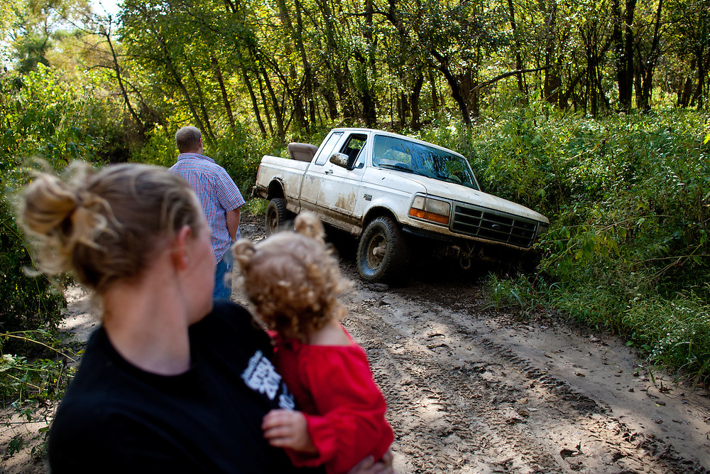 The pick up truck stuck on a ditch during a family outing.