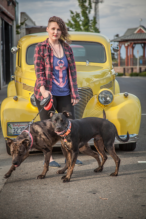 "Customer Care Attendant at Clear Captions, Dayla Pearl with her dogs Luna and Squeaky in Roseville, California  ""I love when people are happy after our phone calls...the service is free and very satisfying.""  (1939 Chevrolet)"