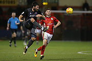 16 Michael Bostwick for Lincoln City clears ahead of 7 Chris Porter for Crewe Alexander during the EFL Sky Bet League 2 match between Crewe Alexandra and Lincoln City at Alexandra Stadium, Crewe, England on 26 December 2018.