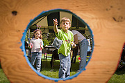 Boy tossing bean bag into whole at Superday in Cheyenne, Wyoming. Model release available. Created on June 26, 2004.