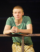 Black Watch <br /> National Theatre of Scotland<br /> written by Gregory Burke and directed by John Tiffany<br /> at The Barbican Theatre, London, Great Britain <br /> press photocall <br /> 26th November 2010 <br /> <br /> Jack Lowden (as Cammy)<br /> <br /> <br /> Photograph by Elliott Franks