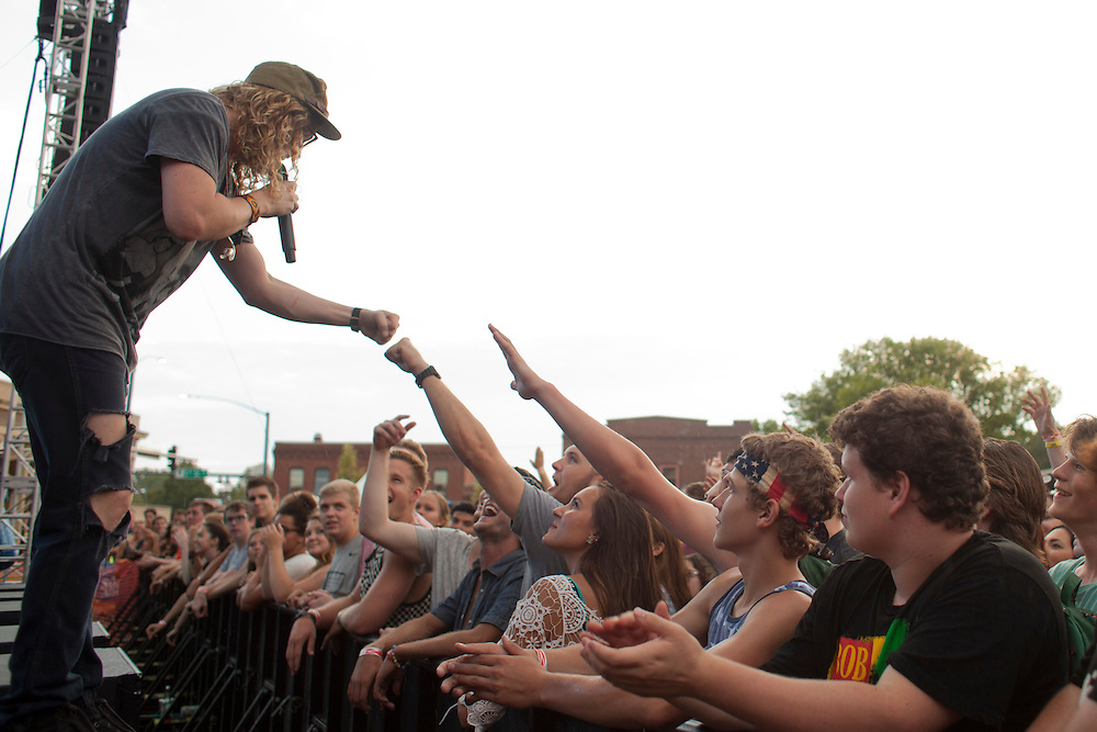 Washington-based soul vocalist and guitarist Allen Stone performs for a packed crowd at the NewBo Music Fest in downtown Cedar Rapids on Saturday, August 8, 2015. Festival organizers sold an estimated 2,900  tickets before the event and NewBo business owners hope the first-time fest will eventually span two days and bring even more alternative headliners to the area. (Rebecca F. Miller/Freelance for the Gazette)