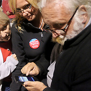 Janis Boroznoff, left LeAnn Pierce and Greg Reynolds try to get election results on a smart phone. (Jason A. Frizzelle)