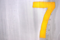 the yellow number seven painted on the side of an aircraft.