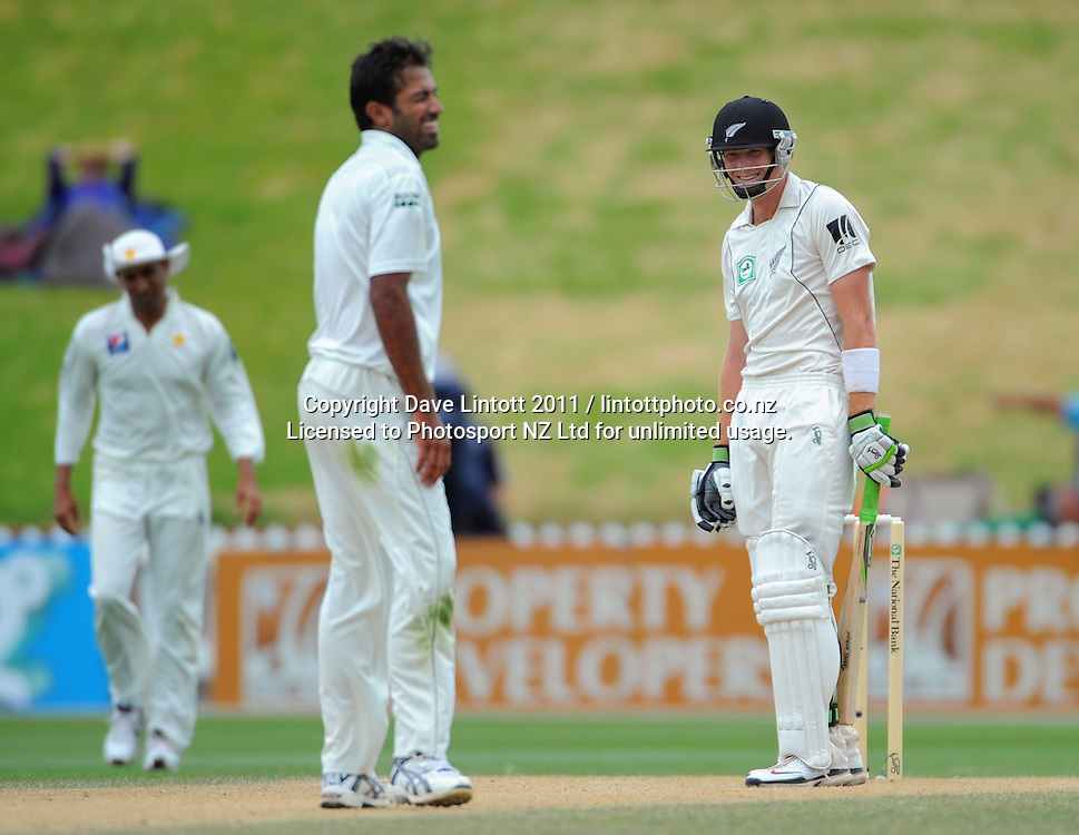 Pakistan bowler Wahab Riaz laughs with Martin Guptill. 2nd cricket test match - New Zealand Black Caps v Pakistan, day four at the Basin Reserve, Wellington, New Zealand on Tuesday, 18 January 2011. Photo: Dave Lintott / photosport.co.nz