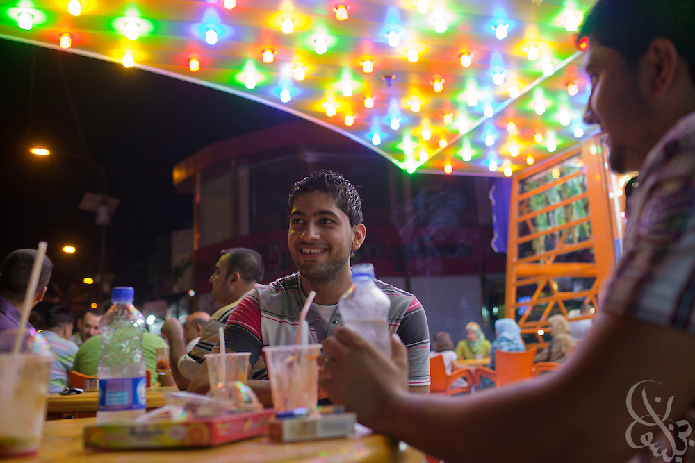 Young Iraqis enjoy an evening out at a recently opened juice bar in the Karradah district of of Baghdad, Iraq August 25, 2010. As security has improved and Iraqis begin to feel more comfortable venturing out again, scores of newly opened restaurants and cafes vie have sprouted up across the city.  .