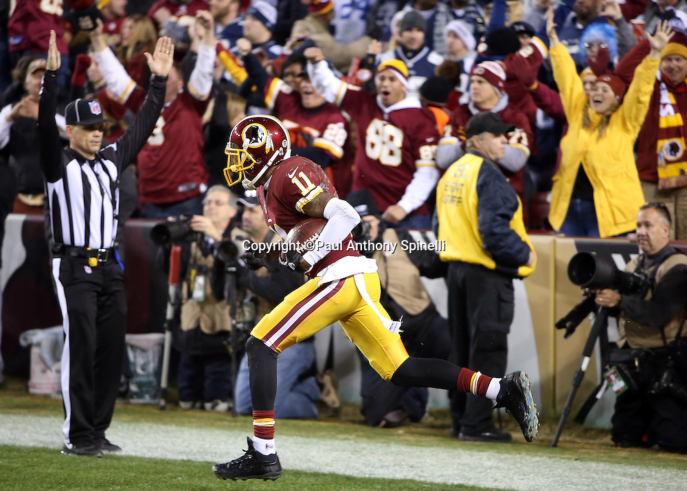 Washington Redskins wide receiver DeSean Jackson (11) celebrates after catching a 28 yard touchdown pass in the end zone that ties the score at 16-16 with less than one minute left in the fourth quarter during the 2015 week 13 regular season NFL football game against the Dallas Cowboys on Monday, Dec. 7, 2015 in Landover, Md. The Cowboys won the game 19-16. (©Paul Anthony Spinelli)