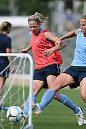25 April 2008: Lindsay Tarpley (l) puts the ball in the net past Christie Rampone (r). The United States Women's National Team held a training session in WakeMed Stadium, formerly SAS Stadium, in Cary, NC.