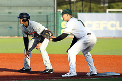 14 May 2016:  Aaron Dudley covers 1st base when Boo Vasquez takes a lead during a Frontier League Baseball game between the Joliet Slammers and the Normal CornBelters at Corn Crib Stadium on the campus of Heartland Community College in Normal Illinois
