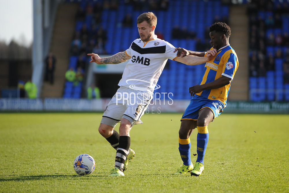 Matthew Kennedy of Port Vale(on loan from Cardiff City) holds off Larnell Cole of Shrewsbury Town (on loan from Fulham FC) during the Sky Bet League 1 match between Shrewsbury Town and Port Vale at Greenhous Meadow, Shrewsbury, England on 25 March 2016. Photo by Mike Sheridan.
