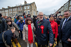 © Licensed to London News Pictures. 12/12/2019. London, UK. Jeremy Corbyn Leader of the Labour Party with his wife Laura and fellow supports leaves his home and walks to the polling Station in Islington to cast his vote in today's General Election. Photo credit: Alex Lentati/LNP
