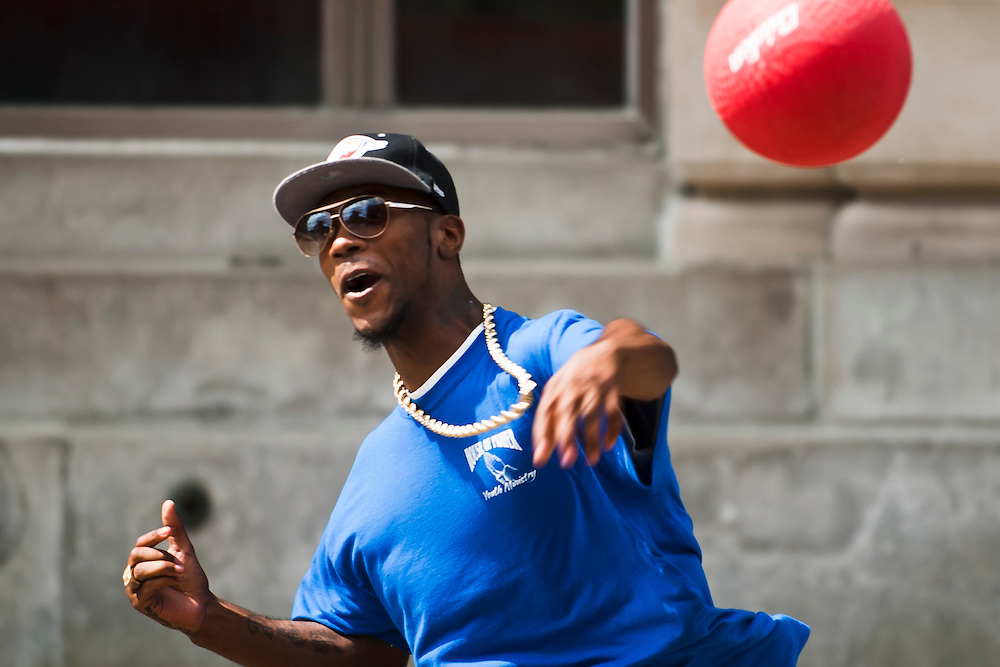Lathan Goumas | MLive.com..Jason Warren, of Flint, throws a ball during a game of dodgeball on Kearsley Avenue as part of the Juneteenth Celebration in downtown Flint on Sunday. About a dozen people gathered on Kearsley Avenue between Saginaw Street and Buckingham Alley to participate in the event.