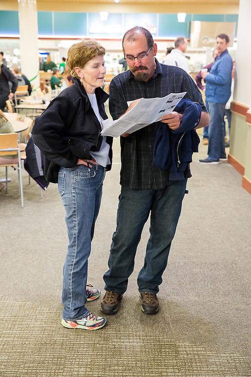 Jeff Baldwin and Lowise Baldwin look at a map deciding where they want to go on their Residence Hall Viewing tour on Oct. 10, 2014.