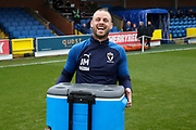 AFC Wimbledon fitness coach Jason Moriarty carrying box ontopitch during the EFL Sky Bet League 1 match between AFC Wimbledon and Southend United at the Cherry Red Records Stadium, Kingston, England on 1 January 2020.