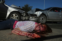 """February 17, 2016 - San Antonio, Texas, U.S. - Johnson High School student Gracelyn Doctor,16, plays the role of an accident victim during the school's """"Shattered Dreams"""" event. The mock accident event features active first responders attending a staged head on collision resulting in death and injuries caused by alcohol consumption and distracted driving. According to the San Antonio Fire Department's public information officer Deborah Foster, the event has been staged at various area schools since 1998. """"This brings home the message that drinking and driving don't mix,"""" Foster said. Students who witness the accident scene will attend a mock funeral the following day. (Credit Image: © John Davenport/San Antonio Express-News/ZUMAPRESS.com)"""