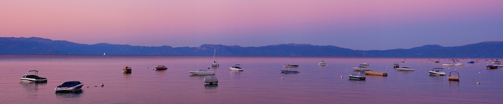 A photo of boats at anchor at sunset on Lake Tahoe in California.
