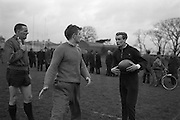 Gibson, right, discussing tactics of back line with p McGrath, centre, and Kiernan, during practice in Dublin on Friday 12th February, 1965, ..Irish Rugby Football Union, Ireland v England, Five Nations, Irish Rugby team practice, Dublin, Ireland, Friday 12th February, 1965,.13.2.1965, 2.13.1965,..Referee- H S Laidlaw, Scottish Rugby Union, ..Score- Ireland 5 - 0 England, ..Irish Team, ..T J Kiernan,  Wearing number 15 Irish jersey, Full Back, Cork Constitution Rugby Football Club, Cork, Ireland,..P J Casey, Wearing number 14 Irish jersey, Right Wing, Landsdowne Rugby Football Club, Dublin, Ireland, ..M K Flynn, Wearing number 13 Irish jersey, Right Centre, Wanderers Rugby Football Club, Dublin, Ireland, ..K J Houston, Wearing number 12 Irish jersey, Left Centre, Bruff Rugby Football Club, Limerick, Ireland, and, Oxford University Rugby Footabll Club, Oxford, England,..P J McGrath,  Wearing number 11 Irish jersey, Left Wing, University college Cork Rugby Football Club, Cork, Ireland,..C M H Gibson, Wearing number 10 Irish jersey, Stand Off, Cambridge University Rugby Football Club, Cambridge, England, and, N.I.F.C, Rugby Football Club, Belfast, Northern Ireland, ..R M Young, Wearing number 9 Irish jersey, Scrum Half, Queens University Rugby Football Club, Belfast, Northern Ireland,..S MacHale, Wearing number 1 Irish jersey, Forward, Landsdowne Rugby Football Club, Dublin, Ireland, ..K W Kennedy, Wearing number 2 Irish jersey, Forward, Queens University Rugby Football Club, Belfast, Northern Ireland,..R J McLoughlin, Wearing number 3 Irish jersey, Captain of the Irish team, Forward, Gosforth Rugby Football Club, Newcastle, England, ..W J McBride, Wearing number 4 Irish jersey, Forward, Bective Rangers Rugby Football Club, Dublin, Ireland,  ..W A Mulcahy, Wearing number 5 Irish jersey, Forward, Bective Rangers Rugby Football Club, Dublin, Ireland,  ..M G Doyle, Wearing number 6 Irish jersey, Forward, University College Dublin Rugby Football Club, Dublin, Ireland,..R A