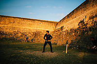 Jaffna, Sri Lanka -- February 9, 2018: Cricket players in the late afternoon sun at Jaffna Fort.