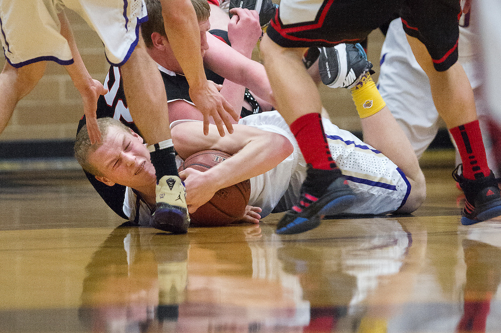 GABE GREEN/Press<br /> <br /> Kellog&rsquo;s Caleb McDonald holds on to a loose ball as a Parma player attempts to take it as the two teams competed Thursday in the 2014 Real Dairy Shootout.