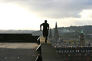 A free runner performing the extreme sport of Parkour, UK 2005