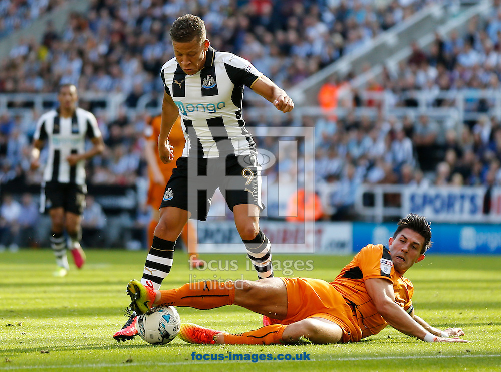 Dwight Gayle (l) of Newcastle United is tackled by Danny Batth of Wolverhampton Wanderers during the Sky Bet Championship match at St. James's Park, Newcastle<br /> Picture by Simon Moore/Focus Images Ltd 07807 671782<br /> 17/09/2016