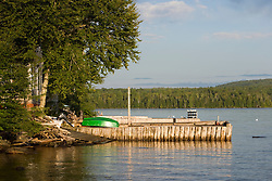 A boat on the dock of one of the few camps on Brassua Lake in Maine's Northern Forest.