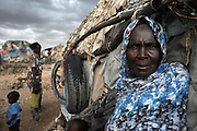 65 year-old Mumina Abdi Barre outside her home in the Kililka Shanad camp for displaced persons, on the outskirts of Hargeisa, Somaliland. Mumina fled to Ethiopia during the civil war in 1988 and returned in 1991, with thousands like her, to find she no longer had a home..