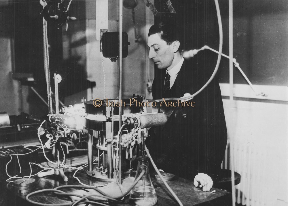 (Jean) Frederick Joliot-Curie (1900-1958), French physicist, in about 1930. The apparatus is a Wilson cloud chamber. Joliot became assistant to Marie Curie in 1925. In 1926 he married Irene Curie and in 1935 shared with her the Nobel prize for chemistry for the discovery of artificial radioactivity.