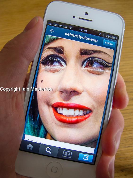 Lady Gaga photograph on Tumblr social media and photosharing app on white iPhone 5 smartphone