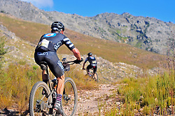 WELLINGTON SOUTH AFRICA - MARCH 22: Isak Pretorius and Tom Wetton ascend a climb during stage three's 111km from Wellington to Worcester on March 22, 2018 in Western Cape, South Africa. Mountain bikers gather from around the world to compete in the 2018 ABSA Cape Epic, racing 8 days and 658km across the Western Cape with an accumulated 13 530m of climbing ascent, often referred to as the 'untamed race' the Cape Epic is said to be the toughest mountain bike event in the world. (Photo by Dino Lloyd)
