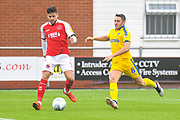 Danny Andrew of Fleetwood Town (3) and Anthony Hartigan of AFC Wimbledon (8) in action during the EFL Sky Bet League 1 match between Fleetwood Town and AFC Wimbledon at the Highbury Stadium, Fleetwood, England on 10 August 2019.