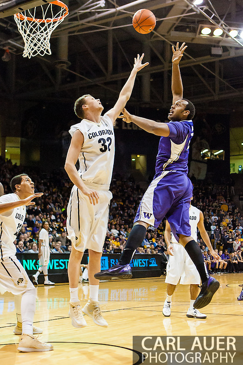 February 9th, 2014:  Washington Huskies senior forward Perris Blackwell (2) throws up a shot over Colorado Buffaloes senior center Ben Mills (32) in the first half of action in the NCAA Basketball game between the Washington Huskies and the University of Colorado Buffaloes at the Coors Events Center in Boulder, Colorado