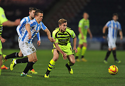Huddersfield Town's Murray Wallace tries to hold back Yeovil Town's Joe Ralls - Photo mandatory by-line: Alex James/JMP - Tel: Mobile: 07966 386802 29/12/2013 - SPORT - FOOTBALL - John Smith's Stadium - Huddersfield - Huddersfield Town v Yeovil Town - Sky Bet Championship