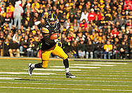 November 02 2013: Iowa Hawkeyes running back Damon Bullock (5) carries the ball during the first half of the NCAA football game between the Wisconsin Badgers and the Iowa Hawkeyes at Kinnick Stadium in Iowa City, Iowa on November 2, 2013. Wisconsin defeated Iowa 28-9.