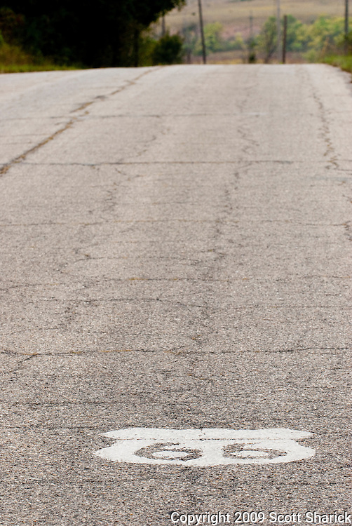 A Route 66 sign painted on the road in Kansas. Missoula Photographer