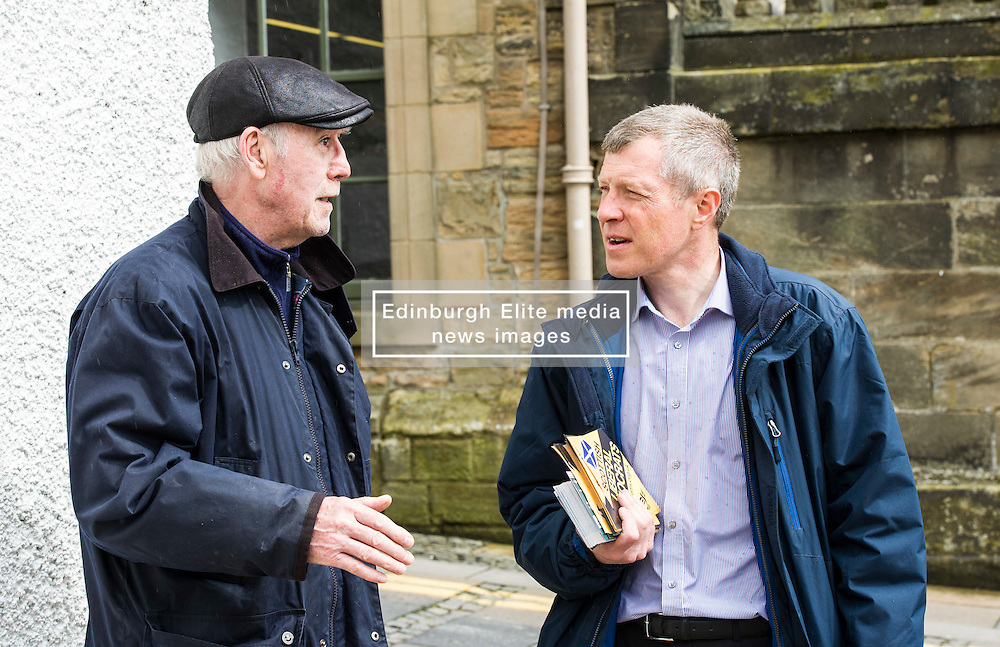 Pictured: Local Sandy Romanes took the chance to discuss local matters with Willie Rennie.<br /> <br /> Scottish Liberal Democrat leader Willie Rennie headed to a rainey Linlithgow today build on his success at the final TV debate ahead of the election on Thursday. The Lib Dems have not  ahd constituency MSP in the area in the past and hope  to change that on Thursday<br /> <br /> Ger Harley | EEm 2 May 2016
