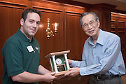 "Yuan-Cheng ""Bert"" Fung, recipient of the 2007 Fritz J. and Dolores H. Russ Prize having breakfast with students in Stocker....Mike Starkey presents OU Clock....Russ Prize winner to speak on biomechanics..Yuan-Cheng ""Bert"" Fung, recipient of the 2007 Fritz J. and Dolores H. Russ Prize, will give a public lecture titled, ?Biomechanics: The Road to Understanding Living Systems,? from 2:10 to 3 p.m. Thursday, Sept. 27, in Ohio University's Baker University Center Theatre.  ..Widely considered the father of modern biomechanics, Fung's diverse research endeavors have formed the basis for the entire field of automotive safety design. They also contributed to the development of artificial skin, improved the effectiveness and longevity of prosthetic devices and enabled the military to develop safer non-lethal weapons and personal body armor. Fung is currently a professor emeritus of bioengineering at the University of California, San Diego, where he founded the bioengineering program...In addition to his public lecture, Fung will also tour Ohio University biomedical engineering labs and meet with Ohio University faculty, leaders, and the Russ College Engineering Ambassadors. ..The late Ohio University graduate Fritz Russ and his wife, Dolores, created the Russ Prize in 1999. The $500,000 award, one of the top three engineering prizes in the world, recognizes engineering achievement that significantly improves the human condition. All Russ Prize winners are invited to give a lecture at Ohio University...Fung's lecture is free and open to the public. A reception will follow outside the theater."