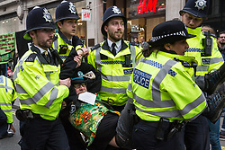 London, UK. 16th April 2019. Police officers arrest a climate protester from Extinction Rebellion at Oxford Circus on the second day of International Rebellion UK activities to call on the Government to take urgent action to address climate change. Credit: Mark Kerrison/Alamy Live News