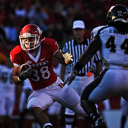 Sep 19, 2009; Piscataway, NJ, USA; Rutgers running back Joe Martinek (38) turns away from Florida International linebacker Scott Bryant (44) during the first half of NCAA college football between Rutgers and Florida International at Rutgers Stadium.
