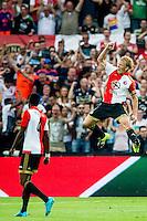 ROTTERDAM - Feyenoord - Vitesse , Voetbal , Seizoen 2015/2016 , Eredivisie , De Kuip , 23-08-2015 , Speler van Feyenoord Dirk Kuyt viert de 1-0 die hij scoort uit een penalty , op de voorgrond de man die verantwoordelijk is voor de strafschop Speler van Feyenoord Terence Kongolo (l)