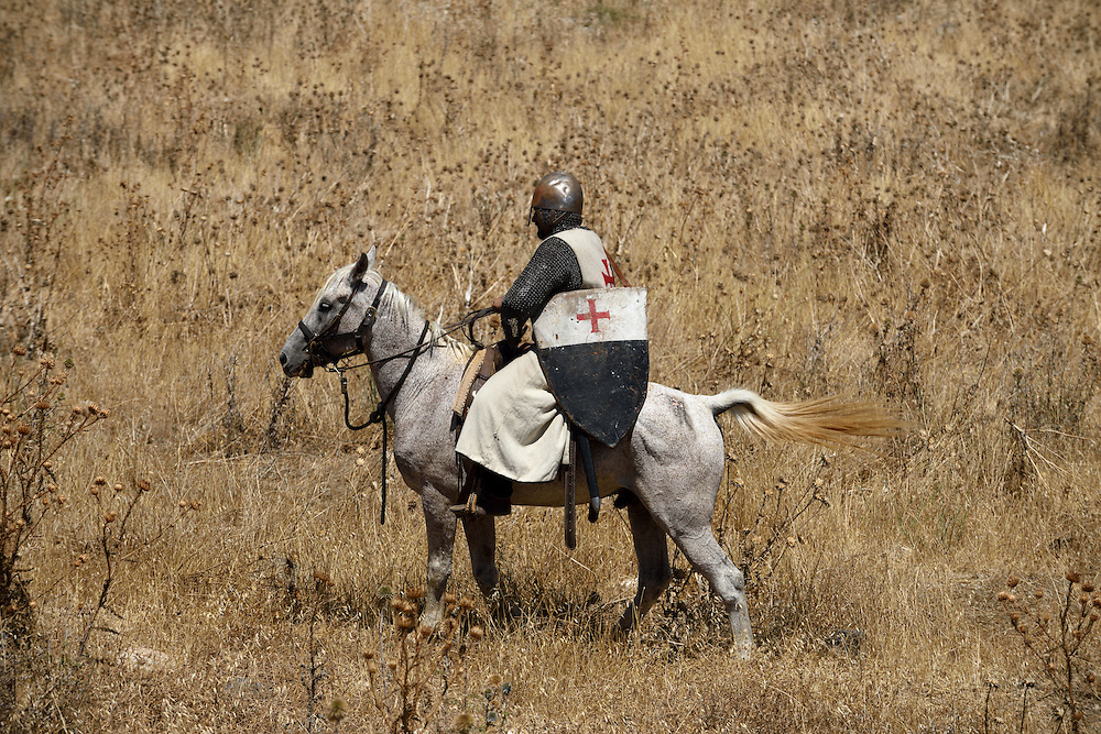 An Israeli man riding a horse and wearing a knight costume takes part in the reenactment of the Hattin Battle in Horns of Hattin, North of Israel on July 4'th 2015.  The Battle of Hattin took place on July 3 and 4, 1187, between the Crusader Kingdom of Jerusalem and the forces of the Kurdish Ayyubid sultan Salah ad-Din, known in the West as Saladin. <br /> The Muslim armies under Saladin captured or killed the vast majority of the Crusader forces, removing their capability to wage war.As a direct result of the battle, Islamic forces once again became the eminent military power in the Holy Land, re-conquering Jerusalem and several other Crusader-held cities.These Christian defeats prompted the Third Crusade, which began two years after the Battle of Hattin. Photo by Gili Yaari <br /> **ISRAEL OUT UNTIL JULY 11'TH, 2015**