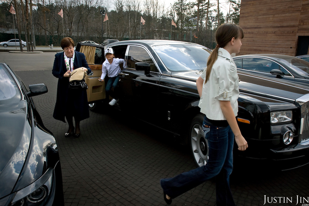 A woman and two young girls get out of a Rolls-Royce at the Barvikha Luxury Village in Moscow.