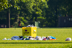 Bags of litter surround bins in Queen's Park, North West London, following the hot, sunny Bank Holiday Monday which saw thousands descend on the capital's parks to enjoy the weather. London, May 08 2018.