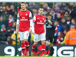 14.12.2013, Etihad Stadium, Manchester, ENG, Premier League, Manchester City vs FC Arsenal, 16. Runde, im Bild Arsenal Mesut Ozil looks dejected as Manchester City score the opening goal // during the English Premier League 16th round match between Manchester City and Arsenal FC at the Etihad Stadium in Manchester, Great Britain on 2013/12/14. EXPA Pictures © 2013, PhotoCredit: EXPA/ Propagandaphoto/ David Rawcliffe<br /> <br /> *****ATTENTION - OUT of ENG, GBR*****