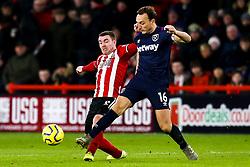 John Fleck of Sheffield United tackles Mark Noble of West Ham United - Mandatory by-line: Robbie Stephenson/JMP - 10/01/2020 - FOOTBALL - Bramall Lane - Sheffield, England - Sheffield United v West Ham United - Premier League