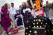 "Dec. 12, 2009 -- PHOENIX, AZ: Matachines get ready to perform during a procession to honor the Virgin of Guadalupe at St. Catherine of Siena Catholic Church in Phoenix, AZ. Most of the members of the church are Hispanic and Dec. 12, Virgin of Guadalupe Day, is one of the church's most important holy days. The Virgin of Guadalupe appeared to Juan Diego, a Mexican peasant, on Dec 9, 1531, on a hillside near Mexico City. She is the ""Queen of Mexico"" and ""Empress of the Americas"" and revered throughout Latin America. Matachine dancers, common in northern Mexico and Mexican-American communities in the US, dance on important religious holidays to honor and venerate God.  Photo by Jack Kurtz"